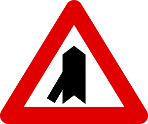 Traffic sign of Belgium: Warning for a crossroad with a sharp side road on the left