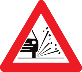 Traffic sign of Belgium: Warning for loose chippings on the road surface